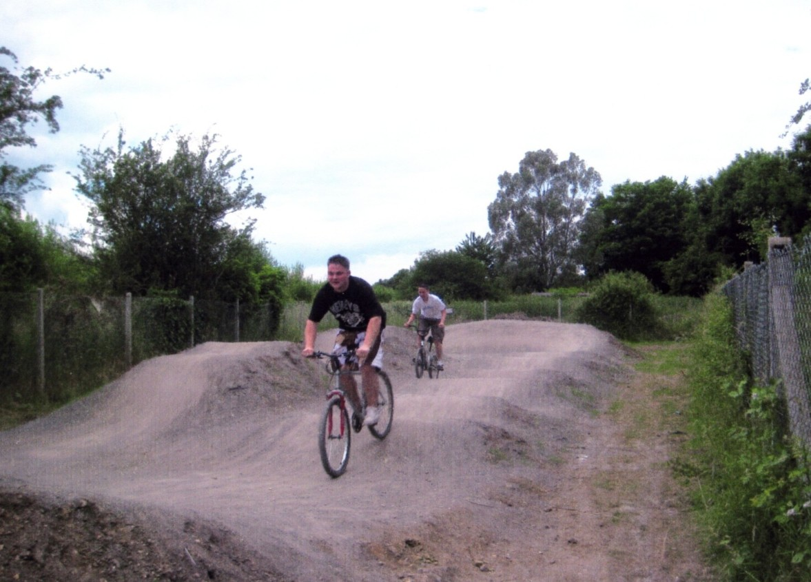 guys riding bikes on a dirt jump