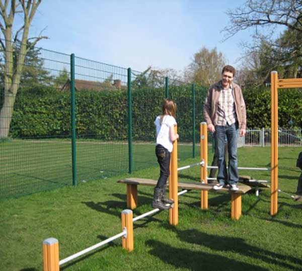 dad and daughter playing on obstacle course